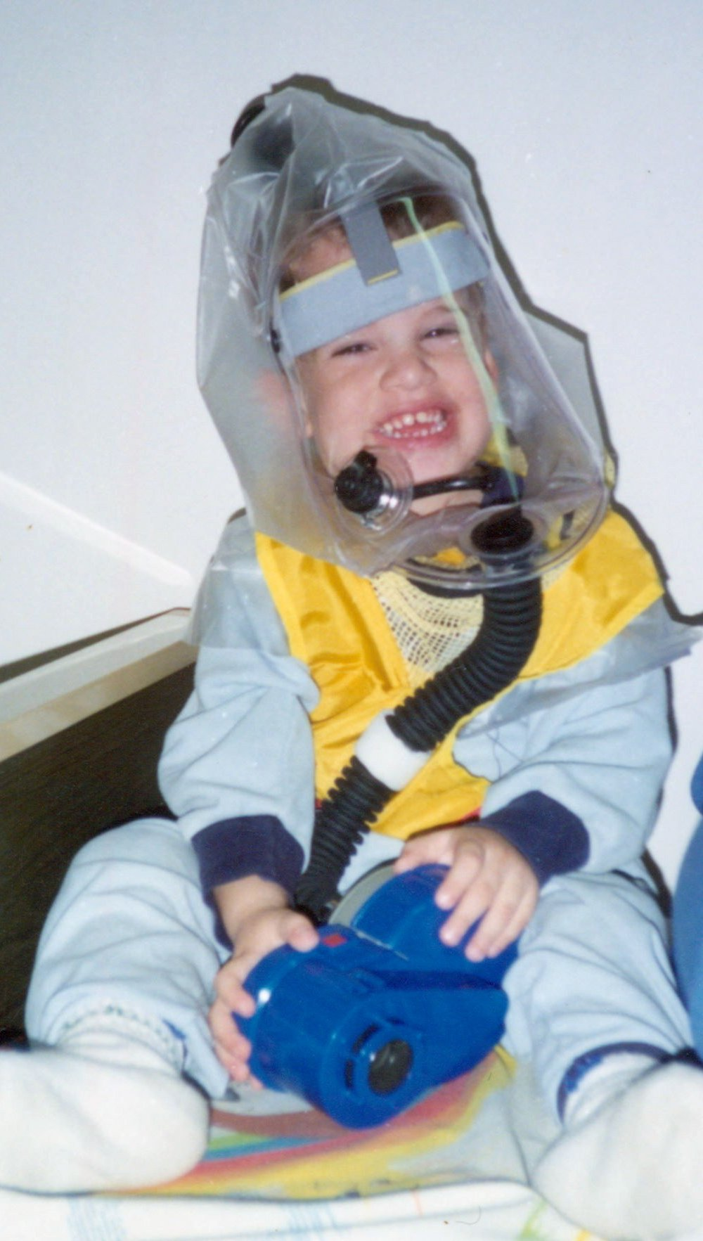 A picture of a child wearing a child's gas mask.