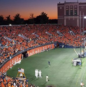 A colorful photo of the Illini stadium and a beautiful sunset in honor of my first-time football