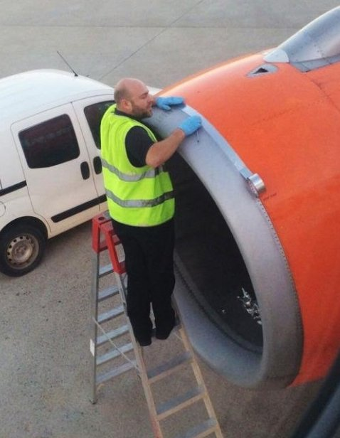 Easyjet engineer taping up his aircraft's engine cover