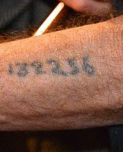 Auschwitz hand tattoo