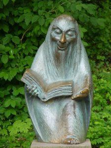 לכתוב ולקרוא - פסל של מספר הסיפורים
